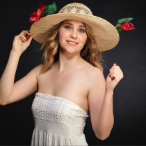 Chloé Mitchell in one of her bespoke hats.  Photograph by Neil Thomas