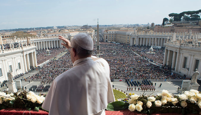 Pope Francis delivering a message at the end Easter mass at the Vatican on March 27